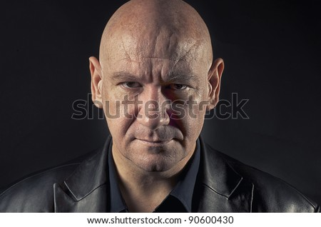 Actor portraying menacing man with  shaved head.
