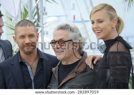 Actor Tom Hardy, Charlize Theron, George Miller attend the 'Mad Max : Fury Road' Photocall during the 68th annual Cannes Film Festival on May 14, 2015 in Cannes, France. - stock photo