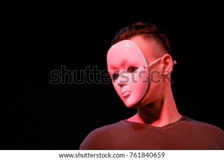 Actor wearing a mask on stage