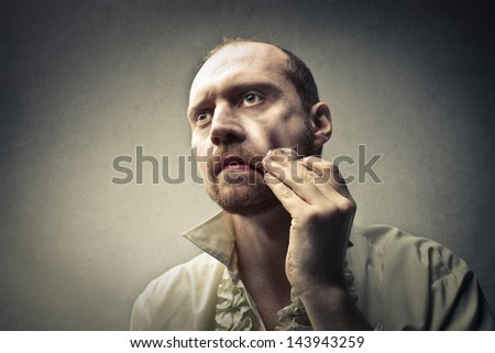 actor wears make-up face - stock photo