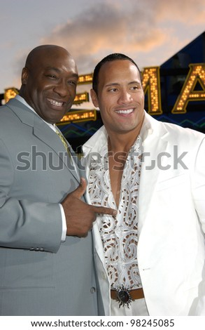 Actors MICHAEL CLARKE DUNCAN (left) & DWAYNE JOHNSON, aka THE ROCK, at the world premiere, in Los Angeles, of their new movie The Scorpion King. 17APR2002.  Paul Smith / Featureflash - stock photo