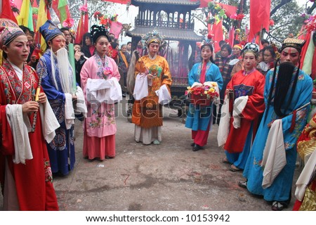 Actors of the local opera troupe dress themselves as the Eight Immortals at a Chinese temple festival in rural China
