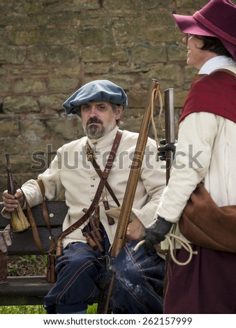 Actors wearing Stuart era,17th century,(reign of king Charles 1st) costumes.They are reenacting the siege of Bolsover Castle, in Derbyshire, UK, an event during the English Civil War.taken  05/05/2014
