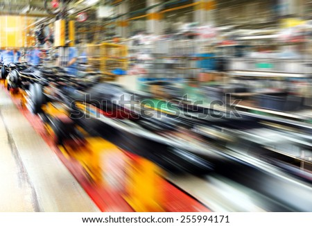 actory floor, car production line, motion blur picture. - stock photo