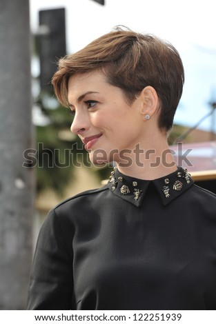 Actress Anne Hathaway on Hollywood Blvd where actor Hugh Jackman was honored with the 2,487th star on the Hollywood Walk of Fame. December 13, 2012  Los Angeles, CA Picture: Paul Smith - stock photo
