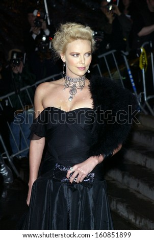 Actress Charlize Theron arrives at the Costume Institute Party of the Year at the MET April 26, 2004 in New York City - stock photo