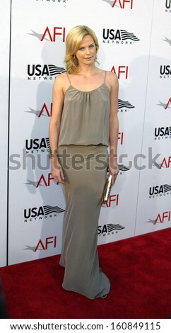 Actress Charlize Theron arrives at the Meryl Streep AFI Lifetime Achievement Award at Kodak Theatre June 10, 2004 in Los Angeles, CA - stock photo