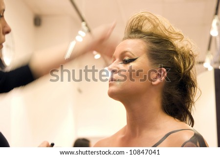 Actress getting make-up before performance - stock photo