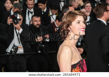 Actress Irene Jacob attends the opening ceremony and premiere of La Tete Haute ( Standing Tall ) during the 68th annual Cannes Film Festival on May 13, 2015 in Cannes, France. - stock photo