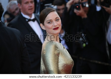 Actress Marion Cotillard leaves the 'From The Land Of The Moon (Mal De Pierres)' premiere during the 69th annual Cannes Film Festival at the Palais des Festivals on May 15, 2016 in Cannes, France.