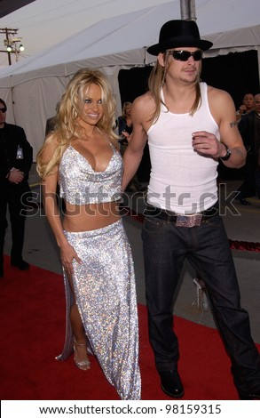 Actress PAMELA ANDERSON & boyfriend KID ROCK at the American Music Awards in Los Angeles. 09JAN2002.   Paul Smith/Featureflash - stock photo