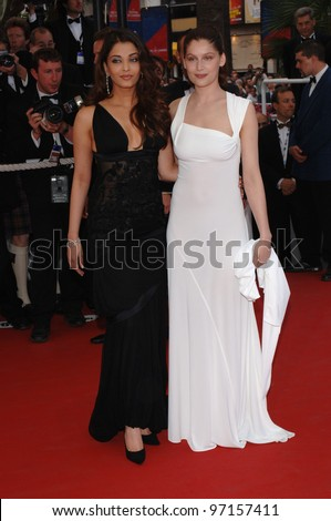 Actresses LAETITIA CASTA (in white) & AISHWARYA RAI at the gala opening of the 58th Annual Film Festival de Cannes.  May 11, 2005. Cannes, France  2005 Paul Smith / Featureflash