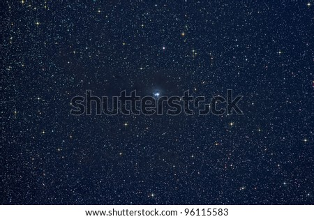Actual astrophotograph.  Iris Nebula.  Hard processed - stars color intensified and diffraction spikes added.  Great science background.  Zoom in for best view. - stock photo