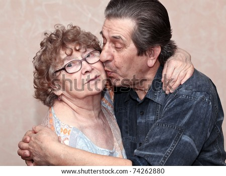 actual gladness of elderly people hugging - stock photo
