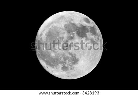 """Actual photograph of the full moon taken at prime focus through an 8"""" Newtonian reflector telescope. Isolated against a black sky. - stock photo"""