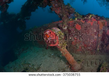 Actual underwater photo of Telegraph on the bridge of wreck ship Nippo Maru in Micronesia. Depth 30 meters.This ship become a home for many fishes and corals since 1942. - stock photo