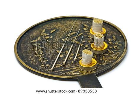 acupuncture needle with moxa cones - stock photo