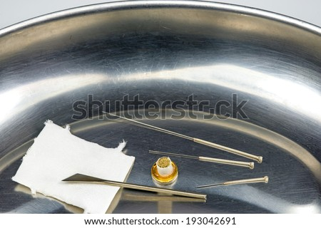 Acupuncture needles - stock photo