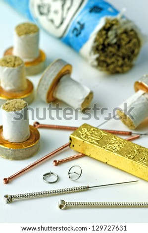 acupuncture needles and moxibustion - stock photo