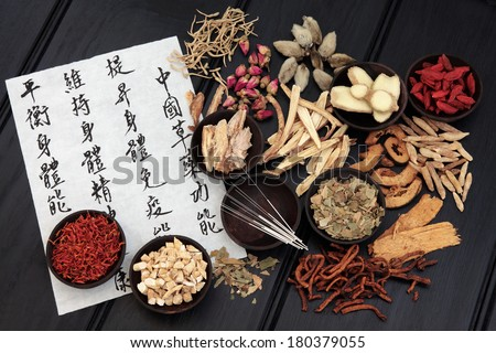 Acupuncture needles with chinese herbal medicine selection. - stock photo