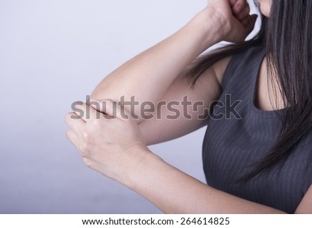 Acute pain at the elbow young women. - stock photo
