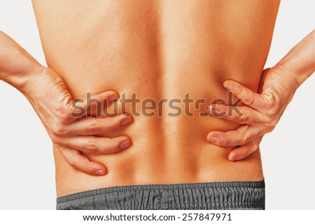 Acute pain in a male lower back.