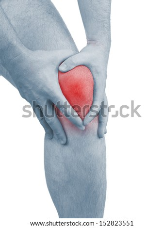 Acute pain in a man  knee. Male holding hand to spot of knee-aches. Concept photo with Color Enhanced blue skin with read spot indicating location of the pain. Isolation on a white background.