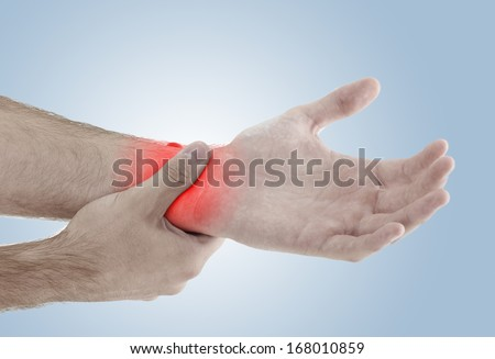 Acute pain in a man palm. Male holding hand to spot of palm-ache. Concept photo with Color Enhanced blue skin with read spot indicating location of the pain.  - stock photo