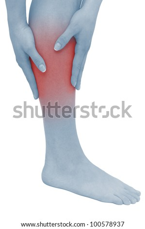 Acute pain in a woman calf. Female holding hand to spot of  calf-aches. Concept photo with Color Enhanced blue skin with read spot indicating location of the pain. Isolation on a white background.
