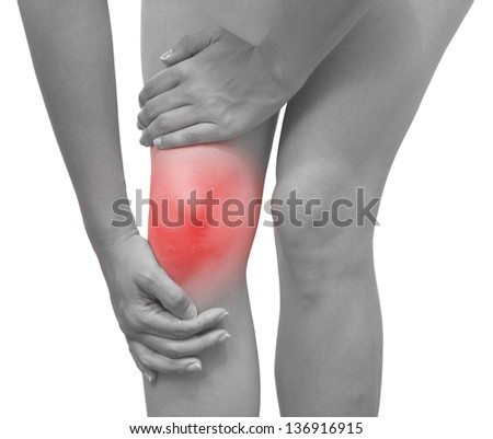 Acute pain in a woman knee. Isolation on a white background. - stock photo