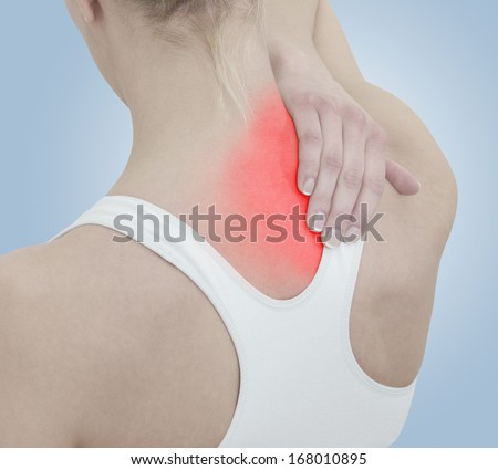 Acute pain in a woman neck. Female holding hand to spot of neck-aches. Concept photo with Color Enhanced blue skin with read spot indicating location of the pain. - stock photo