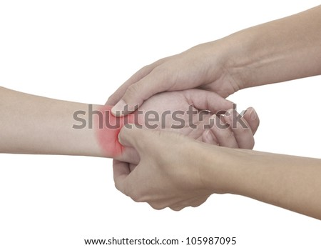 Acute pain in a woman wrist. Female holding hand to spot of wrist pain. - stock photo
