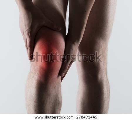 Acute pain of male leg shown with red spot. Bone fracture, emergency concept.  - stock photo