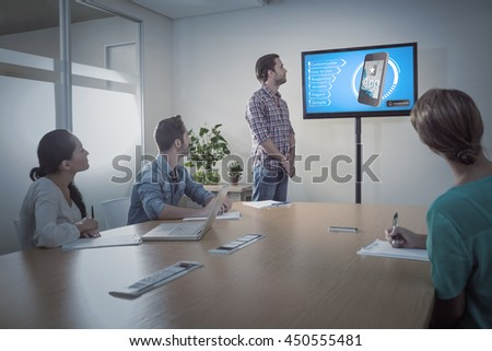 Ad for a new application against attentive business team following a presentation - stock photo