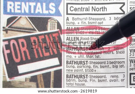 ad for apartment rental circled in red in newspaper - stock photo