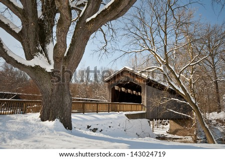 Ada Covered Bridge Wintertime at the historic Ada Covered Bridge in Kent County, Michigan.