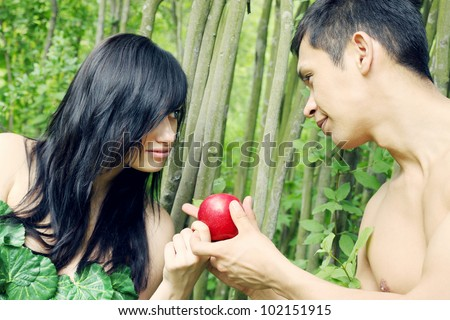 Adam and Eve are going to eat an apple - stock photo