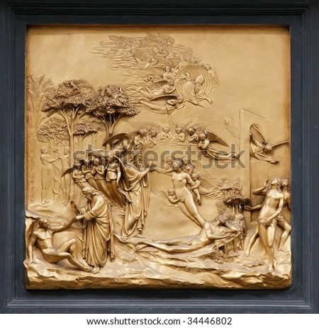 """Adam and Eve by Ghiberti. Detail of the panel on the doors (""""Gates of Paradise"""") of the Duomo Baptistry, Florence, Italy. - stock photo"""