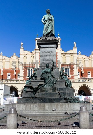 Adam Mickiewicz Monument in Front of the Cloth House in the Main Market Square of the Old Town in Krakow, Poland - stock photo