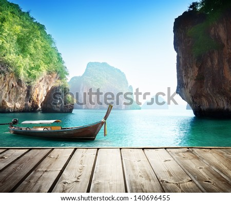 Adaman sea and wooden boat in Thailand - stock photo