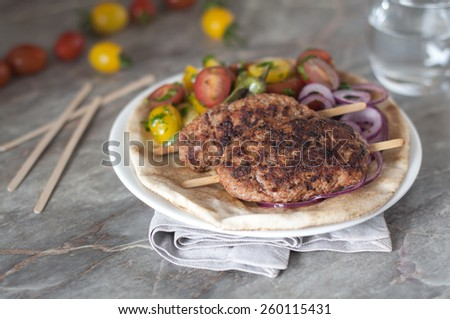 Adana kebab with traditional turkish salads - stock photo