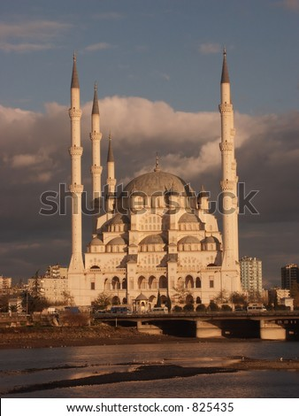 Adana mosque at sunrise - some noise at 100% - stock photo