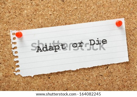Adapt or Die typed on a piece of lined paper and pinned to a cork notice board. A concept for change management and evolving your business to avoid failure and achieve growth. - stock photo