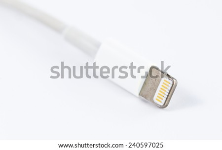 adapter cable of battery charger on white background - stock photo