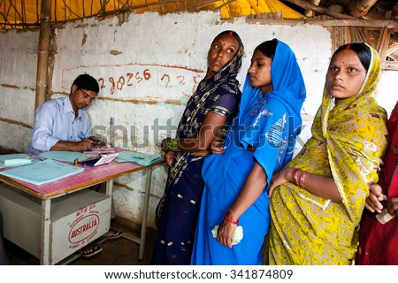 ADAPUR, INDIA-NOV 8: Indian women at a rural pregnancy clinic on 8th Nov 2011 in Adapur, Bihar State, India. Bihar is one of the poorest states in India. The per capita income is about 300 dollars. - stock photo