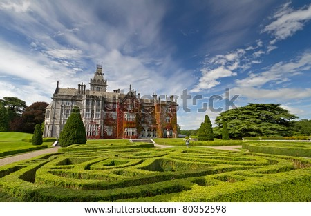 Adare manor in red ivy and gardens in Ireland - stock photo