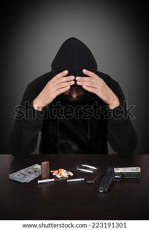 addict in despair on a black background - stock photo