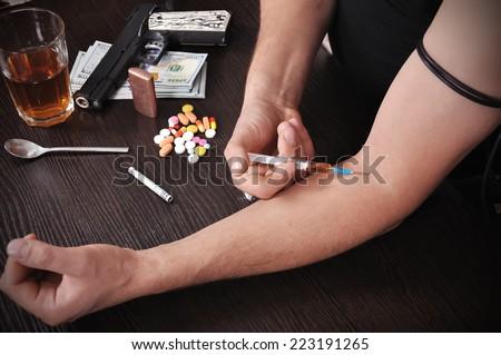 addict takes drugs, close up - stock photo