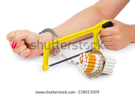 Addiction concept with cigarettes and handcuffs - stock photo