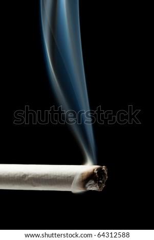Addiction issue - smoking cigarette black isolated - stock photo